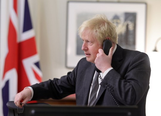 Boris Johnson on the phone at Downing Street
