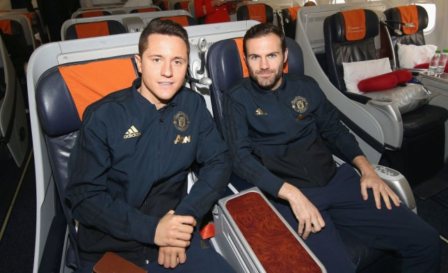 Ander Herrera and Juan Mata of Manchester United board their flight to Valencia at Manchester Airport on December 11, 2018 in Manchester, England.
