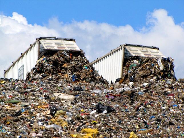 Two dump trucks at landfill