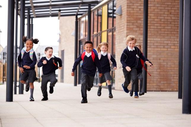 primary school children excitedly running home