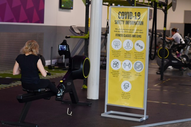 Gym users exercise on the machines at Kensington Leisure Centre in London.