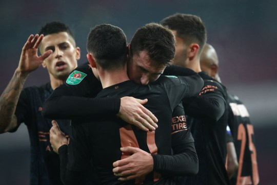 Aymeric Laporte of Manchester City celebrates after scoring their team's fourth goal with teammate Phil Foden during the Carabao Cup Quarter Final match between Arsenal and Manchester City at Emirates Stadium on December 22, 2020 in London, England. The match will be played without fans, behind closed doors as a Covid-19 precaution