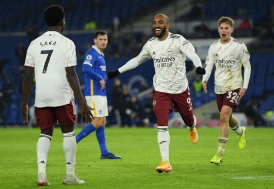 Bukayo Saka and Alexandre Lacazette celebrate Arsenal's goal against Brighton