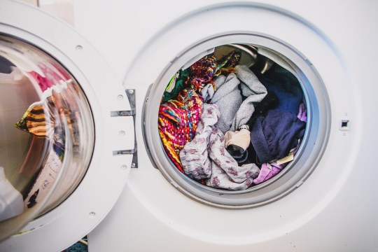 Washing machine full of colourful clothes on Laundry Day