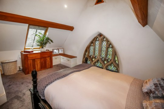 one of the bedrooms in the converted chapel