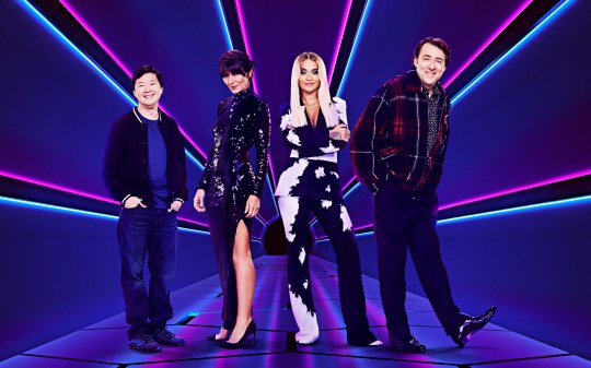 This image is strictly embargoed until 00.01 Friday 27th December 2019 From Bandicoot TV The Masked Singer on ITV Pictured: Ken Jeong, Davina McCall, Rita Ora and Jonathan Ross. This photograph is (C) ITV/Bandicoot TV and can only be reproduced for editorial purposes directly in connection with the programme or event mentioned above, or ITV plc. Once made available by ITV plc Picture Desk, this photograph can be reproduced once only up until the transmission [TX] date and no reproduction fee will be charged. Any subsequent usage may incur a fee. This photograph must not be manipulated [excluding basic cropping] in a manner which alters the visual appearance of the person photographed deemed detrimental or inappropriate by ITV plc Picture Desk. This photograph must not be syndicated to any other company, publication or website, or permanently archived, without the express written permission of ITV Picture Desk. Full Terms and conditions are available on the website www.itv.com/presscentre/itvpictures/terms For further information please contact: james.hilder@itv.com / 0207 157 3052