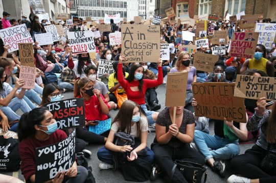 People take part in a protest outside the Department for Education, London, in response to the downgrading of A-level results. PA Photo. Picture date: Sunday August 16, 2020. Thousands of pupils across England have expressed their disappointment at having their results downgraded after exams were cancelled due to coronavirus. Photo credit should read: Jonathan Brady/PA Wire