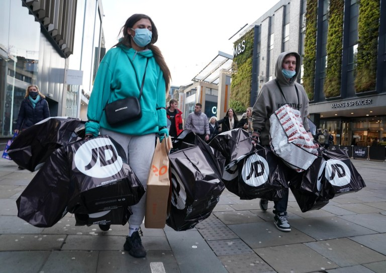 Shoppers laden with bags in Northumberland street, Newcastle, as non-essential shops in England open their doors to customers for the first time after the second national lockdown ends and England has a strengthened tiered system of regional coronavirus restrictions. PA Photo. Picture date: Wednesday December 2, 2020. See PA story HEALTH Coronavirus. Photo credit should read: Owen Humphreys/PA Wire