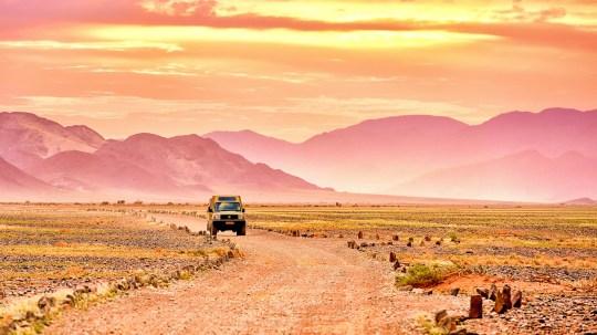 Jeep on desert road, Namibia