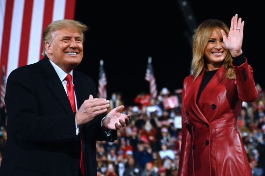 US President Donald Trump stands with First Lady Melania Trump at the end of a rally to support Republican Senate candidates at Valdosta Regional Airport in Valdosta, Georgia on December 5, 2020. - President Donald Trump ventures out of Washington on Saturday for his first political appearance since his election defeat to Joe Biden, campaigning in Georgia where two run-off races will decide the fate of the US Senate. (Photo by Andrew CABALLERO-REYNOLDS / AFP) (Photo by ANDREW CABALLERO-REYNOLDS/AFP via Getty Images)