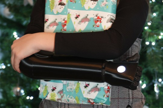 ***ONLINE EMBARGO 14:00 GMT, SUN DEC 6 (09.00 ET)***.Lexi Pitchford, 10, who has received her own bionic arm in time for Christmas, so she can enjoy opening her presents and play with her new toys at home in Stoke on Trent. See SWNS copy SWFTbionic: A schoolgirl has received her own??bionic??arm in time for Christmas ??? so she can enjoy opening her presents and playing with her new toys. Lexi Pitchford, 10, was born without a right hand which has left her struggling with everyday tasks that most people take for granted ??? like holding a pen or tying shoelaces. Mum Emma Mountford, 38, started looking into prosthetics to help her daughter and came across Open Bionics??? ???Hero Arm??? ??? a custom made multi-grip??bionic??limb that costs ??10,000.