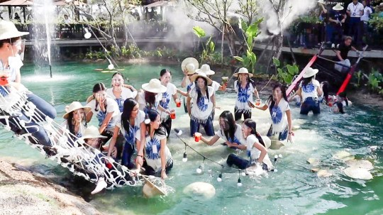 Chiang mai, Thailand, December 7, 2020 (video still)??????NEWS COPY - WITH VIDEO AND PICTURES??????This is the dramatic moment 30 beauty queens plunged into a pond when a bridge snapped. The glamorous Miss Thailand hopefuls were taking part in the second day of the competition in Chiang Mai, Thailand, this morning (Dec 7). As part of the contest, they were visiting a cafe and posing for pictures on a suspension bridge made from ropes connected to a steel walkway. However, the structure could not hold their weight and it snapped - sending them crashing into the filthy water below. Three of the girls were injured with one suffering cuts and bruises on her forehead while the two others had minor scrapes. They were all taken to hospital for a checkup but have been discharged. Worapot Chatkanjana, 43, the embarrassed owner of the restaurant where the event was being held, promised to cover the treatment costs for the injured women. He donated 500,000 Baht (12,500GBP) to cover their bills. He said: ''I'll also pay for the other contestants to have their dresses cleaned professionally. ''I don't know why the bridge broke. It is strong, but it just could not handle the weight of the women. In the future, we will make improvements to the bridge to be even stronger.'' The remaining 27 beauty pageant hopefuls continued the event, with three of their rivals missing. They will rejoin tomorrow. Dr Adisorn Suddee, Director of the Miss Thailand 2020, said: ''Normally the contest is held in Bangkok, but this time we chose Chiang Mai and we were confident that it would be safe and secure. ''This was the second day of the contest and it was unexpected that the bridge would break.'' Beauty pageants are a booming industry in Thailand, with events held regionally and nationally throughout the year. Women can win the equivalent of hundreds of thousands of dollars in cash and prizes - as well as lucrative modelling and sponsorship agreements.