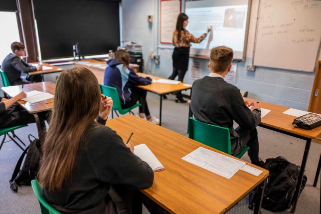 Pupils sit apart during a socially distanced language lesson at Longdendale High School on July 16, 2020 in Hyde, England.