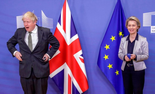 Britain's Prime Minister Boris Johnson (L) and European Commission President Ursula von der Leyen (R) remove their mask as they meet in the Berlaymont building at the EU headquarters in Brussels on December 9, 2020, prior to a post-Brexit talks' working dinner. (Photo by Olivier HOSLET / POOL / AFP) (Photo by OLIVIER HOSLET/POOL/AFP via Getty Images)