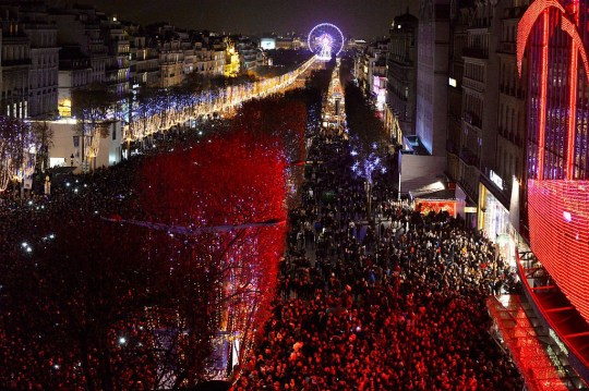 Thousands of revellers celebrate the New Years Eve on the Champs-Elyses