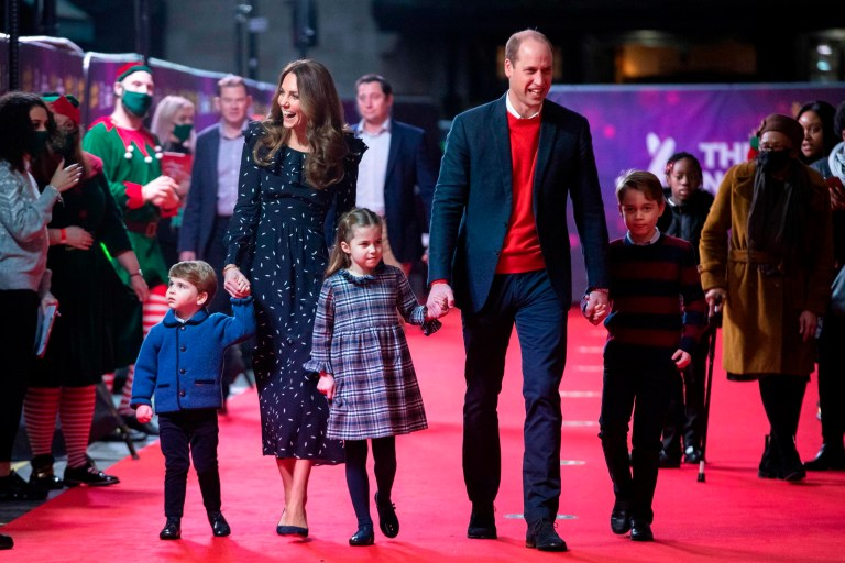 Prince William, Kate and their children arrive to attend a special performance of Pantoland at London's Palladium Theatre
