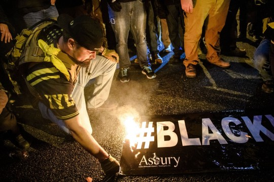 Mandatory Credit: Photo by Amy Harris/REX (11539859dn) A 'Proud Boy' sets fire to a 'Black Lives Matter' flag as they gather in the streets following the 'Million MAGA March' on December 12, 2020 in Washington, DC. Demonstrators Participate In 'Million MAGA March' In DC Following Supreme Court Decision To Reject Texas Lawsuit Challenging Biden's Victory, Washington, USA - 12 Dec 2020