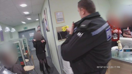 Video grab from the tense footage of James Tallon holding a knife to a woman's throat in Specsavers in Frome, Somerset and threatening to kill a police officer before attempting to hijack a car.
