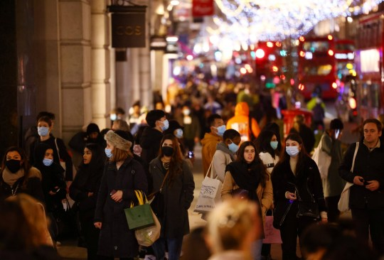People walk on Regent Street as the spread of the coronavirus disease (COVID-19) continues, in London, Britain, December 15, 2020.