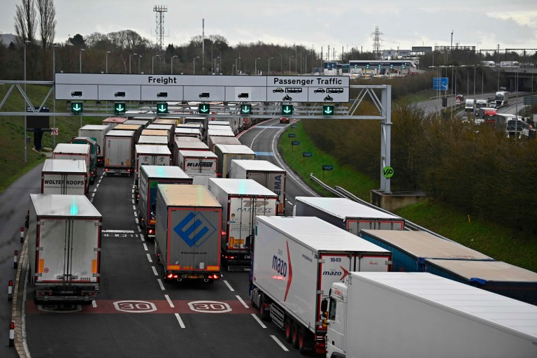 Freight lorries queue at the entrance to the Channel Tunnel Freight terminal in Folkestone on the south coast of England on December 18, 2020. - Questions were asked in the House of Lords on December 17 on the government's state of preparedness for Brexit. UK importers are suffering from delays at Felixstowe and Southampton and there are fears of major delays at Dover from the new year. (Photo by Ben STANSALL / AFP) (Photo by BEN STANSALL/AFP via Getty Images)