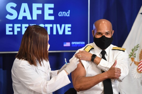 US Surgeon General Jerome Adams is given the Pfizer Covid vaccine