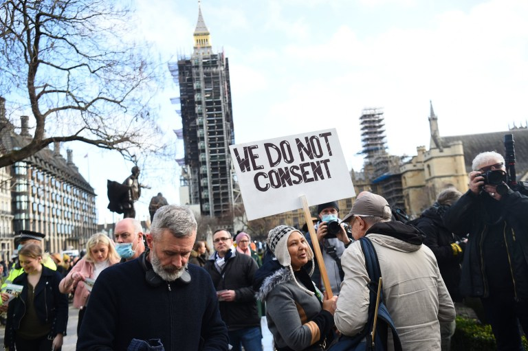 Demonstrators during an anti-lockdown protest in Parliament Square central London. PA Photo. Picture date: Saturday December 19, 2020. See PA story HEALTH Coronavirus. Photo credit should read: Kirsty O'Connor/PA Wire