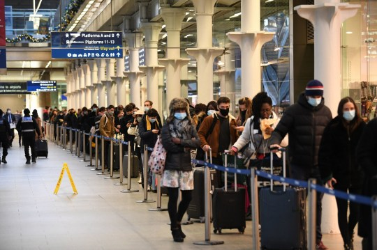 People at St Pancras station in London, waiting to board the last train to Paris today, amid concerns that borders will close and with the public being urged to adhere to Government guidance