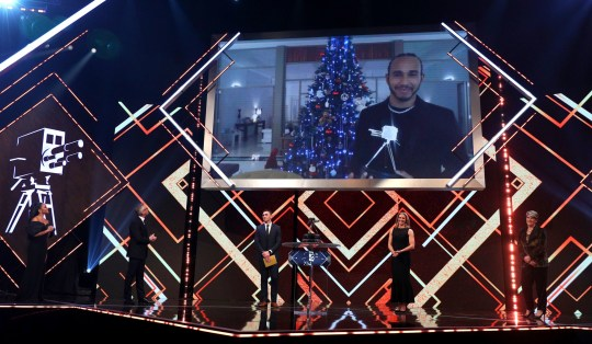 Lewis Hamilton reacts after winning the BBC Sports Personality of the Year Award during the BBC Sports Personality of the Year 2020 at MediaCityUK, Salford. PA Photo. Picture date: Sunday December 20, 2019. See PA story SPORT Personality. Photo credit should read: Peter Bryne/PA Wire.