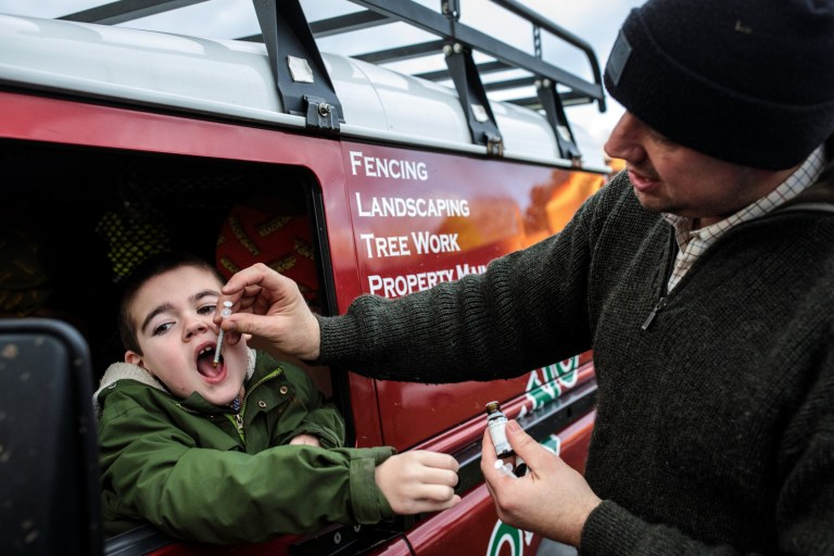 KENILWORTH, ENGLAND - JANUARY 13: Alfie Dingley is given his cannabis oil medicine by his father Drew Dingley as he sits in their car at Kenilworth Castle on January 13, 2019 in Kenilworth, England. Alfie Dingley, aged seven, suffers from PCDH19 which is a rare form of epilepsy that causes seizure clusters and learning difficulties. In June 2018, Alfie was granted a special license by the Home Office to use medicinal cannabis oil to treat his condition. Prior to taking his cannabis-based medicine, the recurrent seizures saw Alfie being rushed to hospital every 4-7 days but since taking cannabis oil Alfie has been seizure-free since July 2018. This treatment has allowed him to take up physical activities like cycling and horse riding. His mother, Hannah Deacon, continues to campaign for access to medicinal cannabis after newly published medical guidelines restrict its use. This currently leaves Alfie as the only holder of an NHS prescription for cannabis oil in the country. (Photo by Jack Taylor/Getty Images)