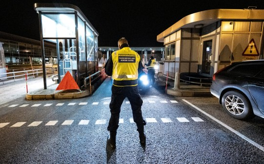 A border control officer stands at Oresund bridge connecting Sweden and Denmark as the Swedish government decided to close the border to visitors from Denmark on Tuesday, due to the spread of COVID-19, December 22, 2020. Johan Nilsson/TT News Agency/via REUTERS ATTENTION EDITORS - THIS IMAGE WAS PROVIDED BY A THIRD PARTY. SWEDEN OUT.