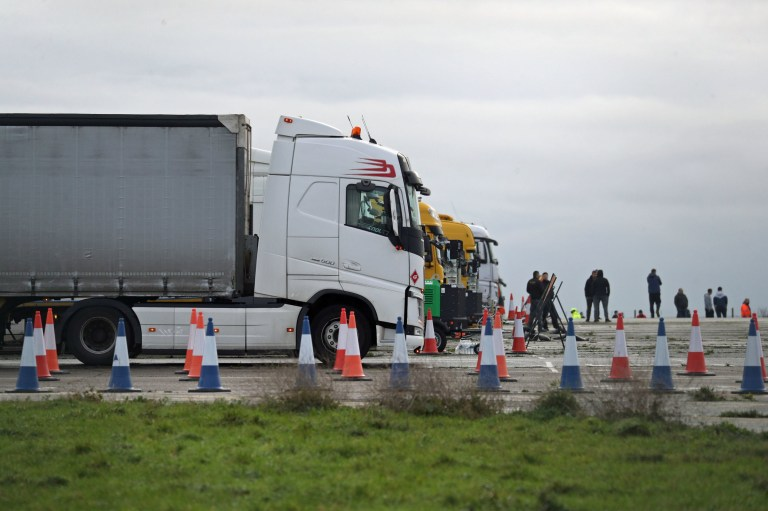 Freight lorries lined up at the front of the queue on the runway at Manston Airport, Kent, after France imposed a 48-hour ban on entry from the UK in the wake of concerns over the spread of a new strain of coronavirus. PA Photo. Picture date: Tuesday December 22, 2020. More than 1,500 lorries are backed up in Kent, unable to make the crossing to France, with drivers having spent a second night sleeping in their cabs. See PA story HEALTH Coronavirus Kent. Photo credit should read: Andrew Matthews/PA Wire