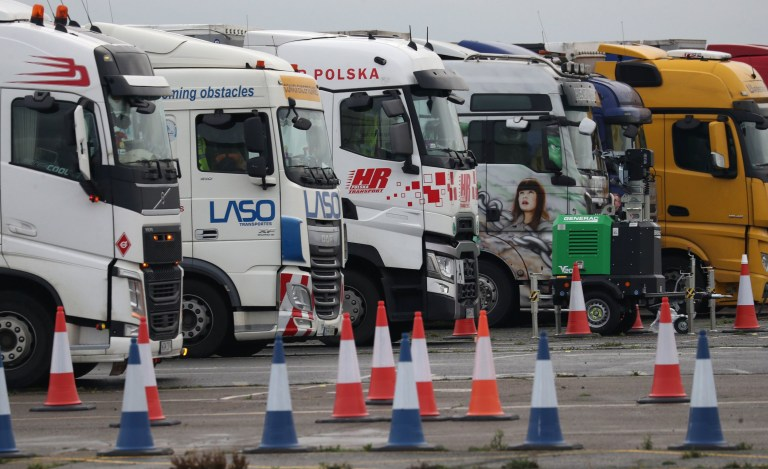 Freight lorries lined up at the front of the queue on the runway at Manston Airport, Kent, after France imposed a 48-hour ban on entry from the UK in the wake of concerns over the spread of a new strain of coronavirus. PA Photo. Picture date: Tuesday December 22, 2020. France has closed its border with the UK over fears of the mutant strain of coronavirus, prompting delays for freight lorries heading across the Channel. See PA story HEALTH Coronavirus. Photo credit should read: Andrew Matthews/PA Wire