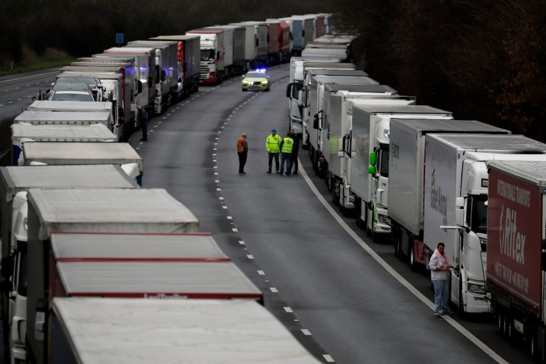 Trucks are parked on the M20 motorway as part of Operation Stack, whilst the Port of Dover remains closed, in southern England, Tuesday, Dec. 22, 2020.