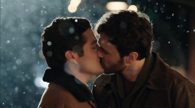 Blake Lee and Ben Lewis kiss in The Christmas Setup movie