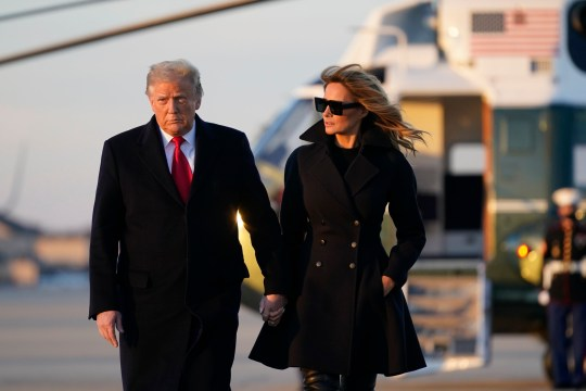 President Donald Trump and first lady Melania Trump board Air Force One at Andrews Air Force Base, Md., Wednesday, Dec. 23, 2020. Trump is traveling to his Mar-a-Lago resort in Palm Beach, Fla. (AP Photo/Patrick Semansky)