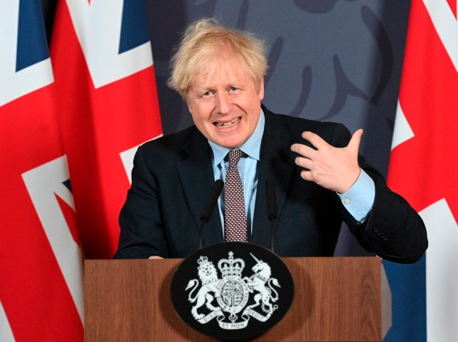 Boris Johnson speaks during a media briefing in Downing Street today