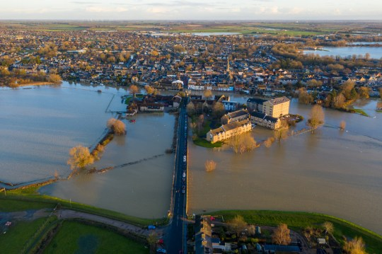 PIC BY GEOFF ROBINSON PHOTOGRAPHY 07976 880732. Picture dated December 24th shows St Ives in Cambridgeshire after the River Great Ouse burst its banks that caused flooding in the region with more bad weather forecast for Boxing Day. Weather warnings are in place for large parts of the UK on Boxing Day, with Storm Bella expected to bring heavy rain and winds of up to 80mph. It comes as parts of the country have already seen flooding in the past few days, with emergency services receiving hundreds of calls. Christmas Day will be calm and cold, with a very minimal chance of snow, according to the Met Office. However, conditions are set to become increasingly unsettled on 26 and 27 December.