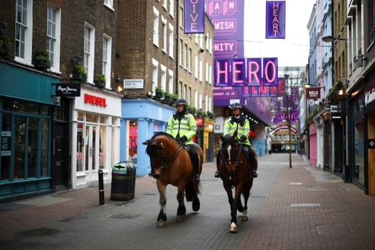 Mounted police on Carnaby Street as shops remain closed under Tier 4 restrictions, amid the coronavirus disease (COVID-19) outbreak, in London, Britain, December 26, 2020. REUTERS/Henry Nicholls