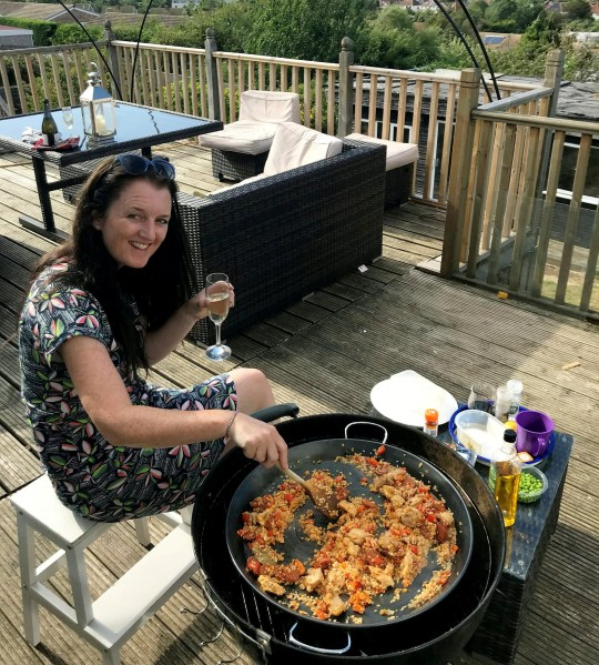 Sarah Govier cooking outside