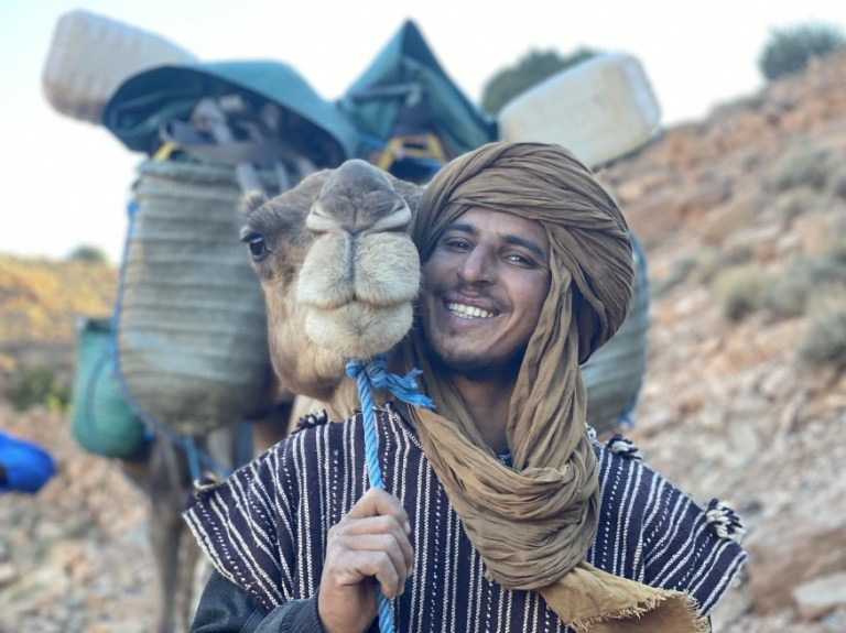 One of Alice Morrison's guides posing with a camel