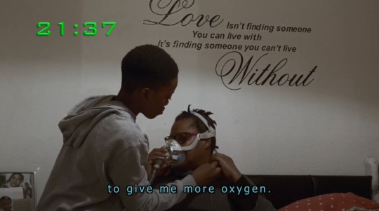 A young carer helps his mother with a machine to help her with sleep apnoea (Picture: The Honeypot Children's Charity)