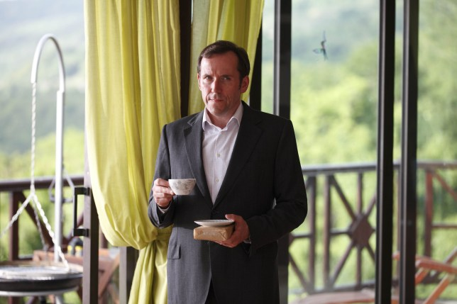 Ben Miller drinking tea in Death in Paradise