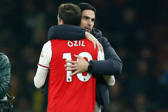 Mesut Ozil hugs Mikel Arteta after Manchester United's clash with Arsenal