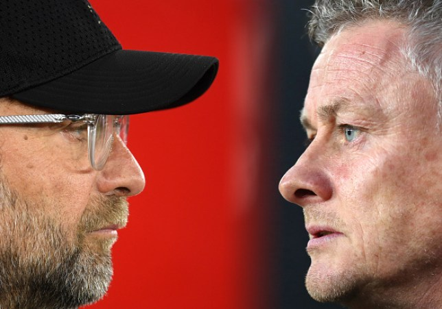 Jurgen Klopp and Ole Gunnar Solskjaer look on ahead of Liverpool's Premier League clash with Manchester United