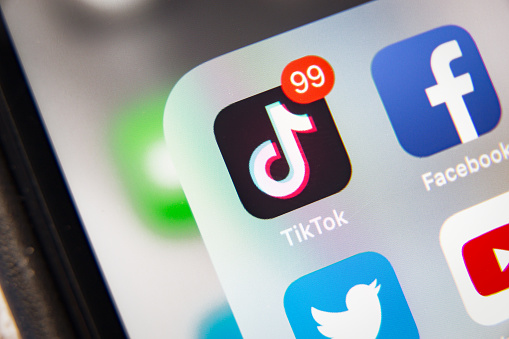 TikTok and Facebook application  on screen Apple iPhone XR