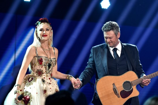 Singer Blake Shelton performing with his fiancée Gwen Stefani on stage