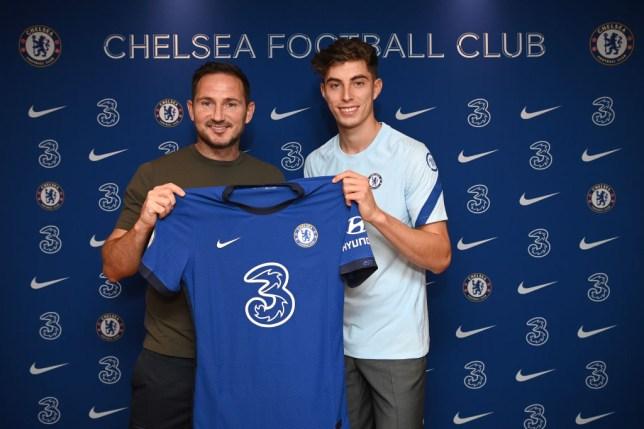 Kai Havertz signs for Chelsea FC alongside Head Coach Frank Lampard at Stamford Bridge on September 4, 2020 in London, England.