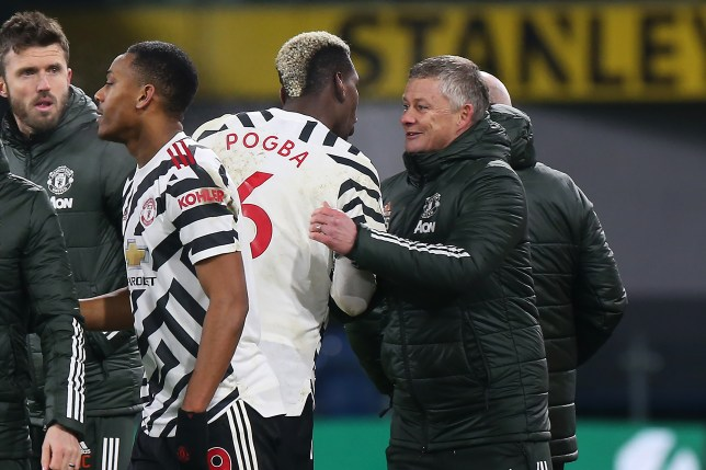 Paul Pogba and Ole Gunnar Solskjaer celebrate Manchester United's win over Burnley in the Premier League