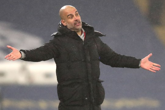 Pep Guardiola looks on during Manchester City's clash with Brighton