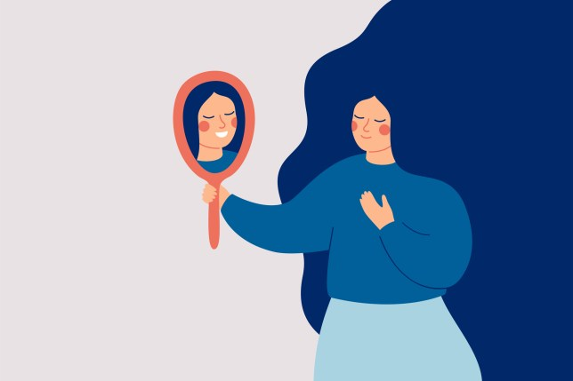 Young woman looks at the mirror and sees her happy reflection.